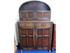 A Dutch style oak dress with cupboards & drawers,