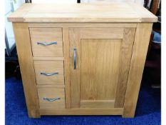 A small oak hall cupboard with drawers, 31.5in wid