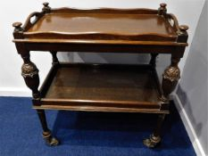 An early 20thC. oak trolley with detachable butler
