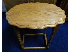 An oak barley twist occasional table with scallope