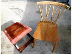 A 1950's Ercol elm seated candlestick chair twinne