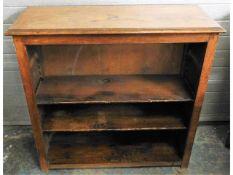 A low level oak bookcase, 36.25in wide x 35.375in
