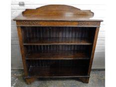 A low level oak bookcase, 40.5in high x 36.25in wi