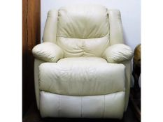 A leather electric recliner chair in cream