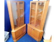 A pair of Turnidge of London teak corner display c