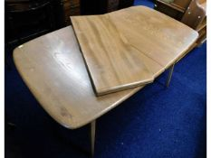 A retro Ercol extending dining table with two leav