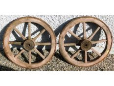 A pair of iron clad cart wheels 21in diameter