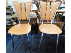 A pair of retro French style chrome fan back chair