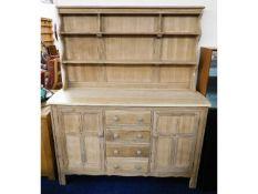 A stripped, unfinished Ercol dresser, 66.5in high