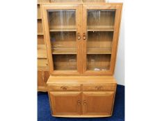 A retro styled Ercol elm bookcase & cupboard, 63.5