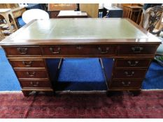 A large pedestal desk with nine drawers with key,