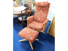 An Ercol swivel armchair with matching footstool,