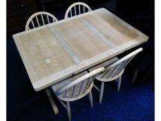 An Ercol extending oak dining table, later strippe