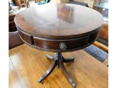 A modern Regency style mahogany drum table, 23in h
