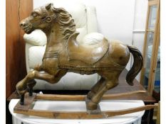 An antique pitch pine carved galloping pony, belie