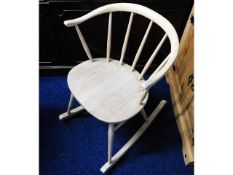 An Ercol elm seated rocking chair, later stripped