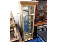 A pine display cabinet with mirrored back & glass