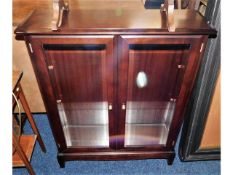 A modern mahogany display cabinet with glass shelv