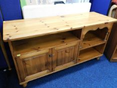 A low level pine entertainment cabinet, one handle