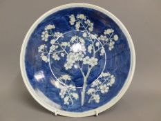 A late 19thC. Chinese blue & white prunus plate, 1