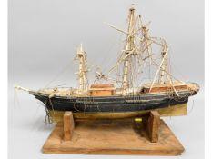 A folk art bone & wood model ship, some faults, in