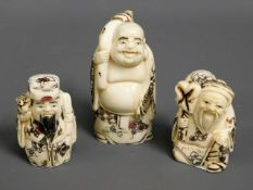 Three carved Japanese carved bone netsuke figures,