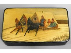An antique Russian lacquerware snuff box with snow
