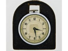 A vintage leather mounted fob watch, glass backed