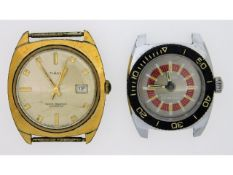 A Timex water resistant 25m watch twinned with a T