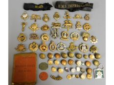 A quantity of military cap badges, buttons & tags