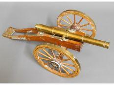 A brass model desk canon, 18.5in long