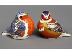 Two Royal Crown Derby porcelain paperweights, silv