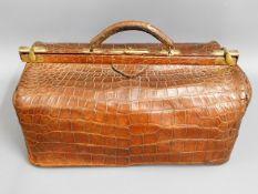 A James Shoolbred crocodile skin Gladstone bag, 17