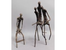 Two bronze stick figure groups in the manner of Al