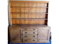 A large antique pitch pine dresser with two cupboa