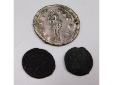 A Roman silver coin & two others in bronze