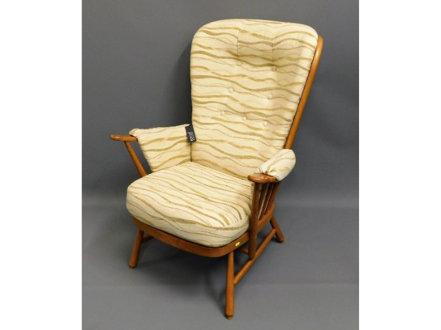 An upholstered blond Ercol chair with original lab