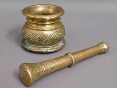 An 18thC. bronze pestle & mortar