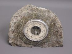 A serpentine mounted barometer