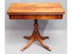 A Regency style mahogany card table with brass cla