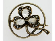 A 19thC. yellow metal brooch, tests electronically