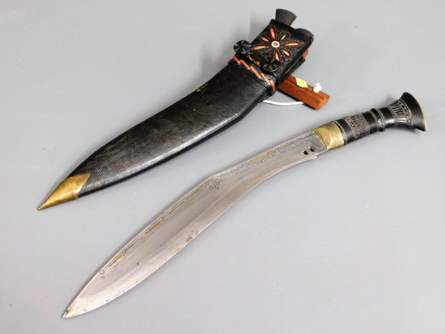 A kukri knife with leather scabbard, 17.125in long