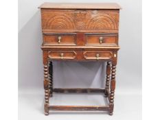 An 18thC. oak bible box with stand, 41.75in high x