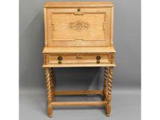 A 1920's ladies oak bureau with barley twist legs,