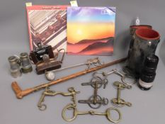 A Beatles album, one other, some brass horse bits,