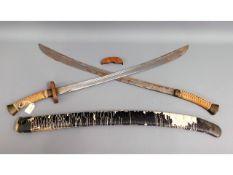 A Tibetan double sword & scabbard a/f, 39in long