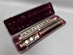 "A cased rosewood flute, impressed mark ""J. Francis"