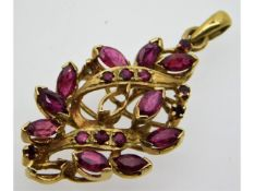 A 9ct gold pendant set with ruby, lacking one ston