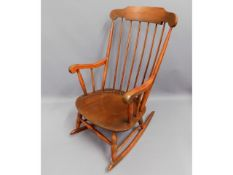 A stained rocking chair, 40.5in high to back