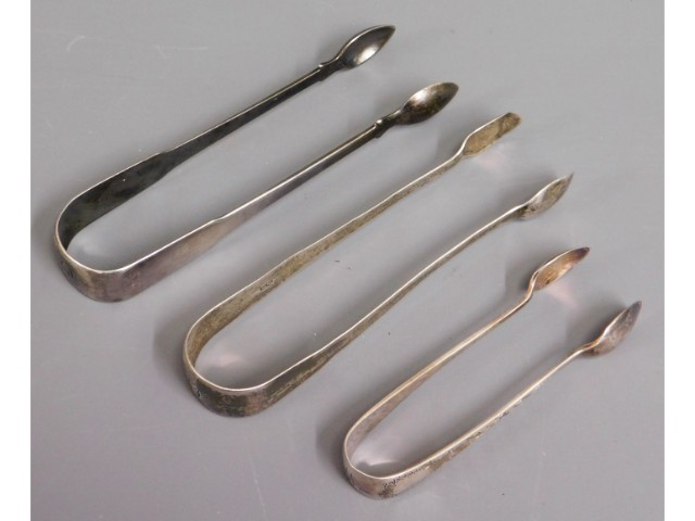 Three pairs of silver tongs including James Deakin